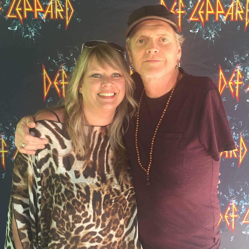 Heather is wearing an ICJUK exclusive limited edition leopard print flow top with Rick Allen