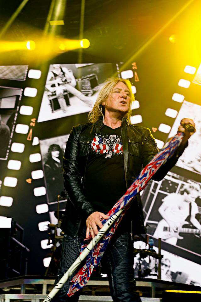 Photo by Ross Halfin - Joe Elliott in the USA Cross and Skull design.